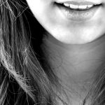 woman upper teeth smile