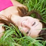 Girl wearing pink lying on the grass
